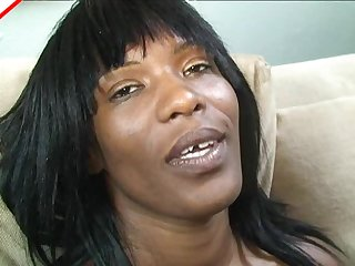 Gap toothed black milf tries her best to swallow white cock
