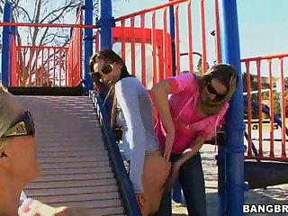 Lesbian Threesome In A Public Playground With Horny Babes