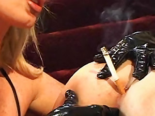 The lesbdom video features a collared and leashed submissive doing what mistress commands.