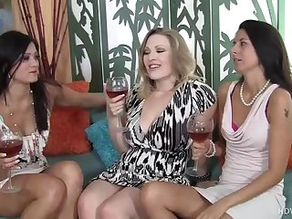 Don't miss this steamy party. Watch this foursome in which this MILF sluts are giving a blowjob and then getting fucked on the sofa while rubbing their love tunnels.