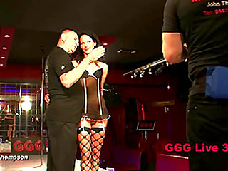 In front of a large audience guys fuck strippers on stage