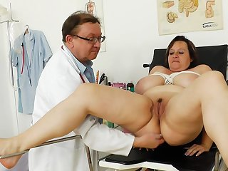 Czech doctor is checking out trimmed pussy and clit of sexy mature BBW girl Olena on a medical chair.