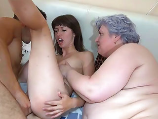 Take a look at this mature woman and brunette chick sucking meaty rockets and getting nailed in this foursome.