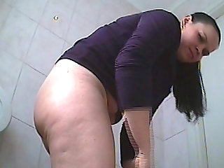 Sweet brunette poses on the hidden camera and pissing so sexy