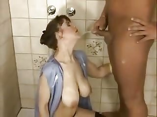 Andrea drinking piss from big belly cock
