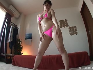 Fat booty Asian girl in a thong gets her pussy vibrated