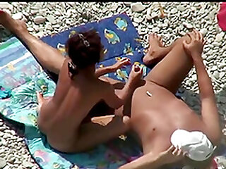 Hot girl playing with a stranger's cock on the beach