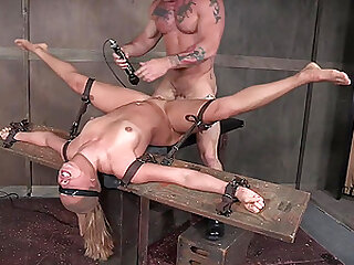 Blindfolded submissive babe Julia Waters tied to a pole and fed cock