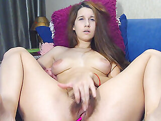 Brunette busty camgirl masturbating her hairy pussy in front of the webcam