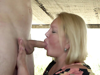Mature blonde BBW Oksana sucks and rides a younger guy outdoors