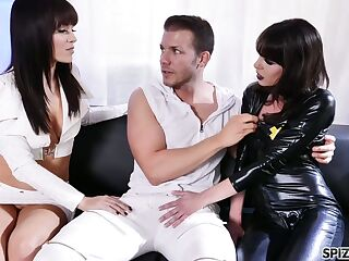Two sex-starved bitches in latex outfits are fucked hard by hot blooded dude