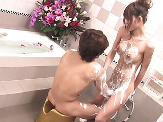 The naughty Japanese wife enjoys a soapy adventure in the tub