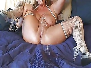 Horny Mature Blonde Fucks Her Shaved Pussy With a Sex Toy Until Squirting